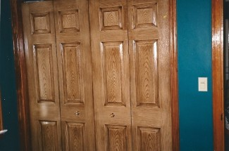 The stained closet doors. Notice how close the new trim matches the original trim to the right.