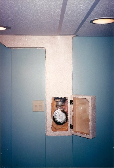 the door of the clean out cover open for access to drain