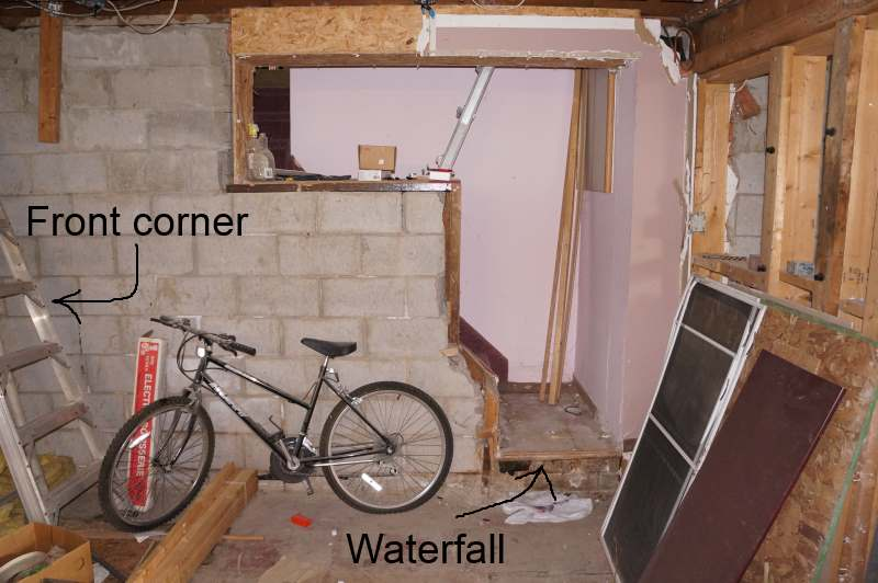 The addition has a small stairway going to the basement of the original  house where the previous owner cut a hole in the old foundation wall.