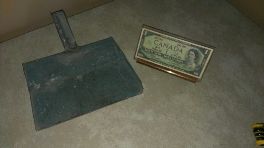dustpan and dollar bill display