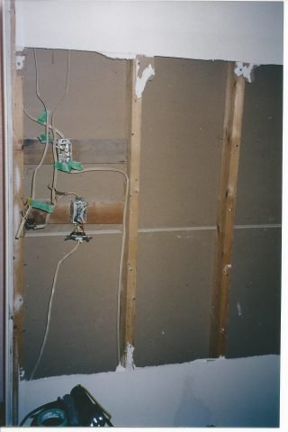 drywall removed to expose wiring